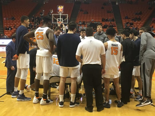 UTEP huddles during a timeout during the game with Rice on Saturday night at the Don Haskins Center.