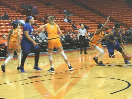 UTEP's Neidy Ocuane defends the drive of Middle Tennessee's