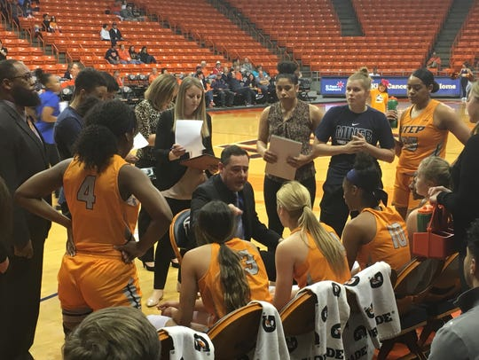 UTEP coach Kevin Baker instructs his team during the