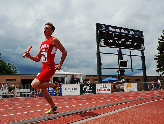 "Lincoln's Isaac Bindert runs in the ""AA"" Boys 1600-meter relay during the South Dakota State Track and Field Meet on Saturday, May 31, 2014, at Howard Wood Field in Sioux Falls."