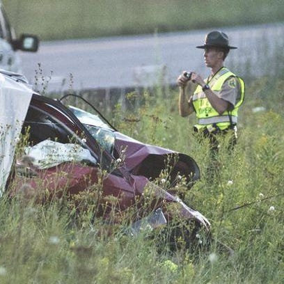 A member of the Vermont State Police processes the scene Thursday of a fatal accident on Interstate 89 in Richmond.