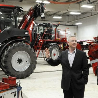 John W. Miller, left, former president of Miller-St. Nazianz discussed the company with now Sen. Tammy Baldwin in this file photo from 2012. CNH Industrial America purchased the company last fall.