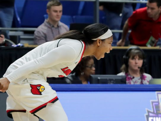 Louisville's Myisha Hines-Allen celebrates after the