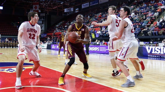 Mount Vernon's Jayquan Smith (35) goes up for a shot during the NYSPHSAA boys Class AA final against Fairport at Floyd L. Maines Veterans Memorial Arena in Binghamton on Sunday, March 19, 2017.