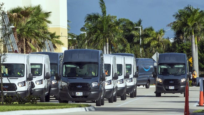 Amazon trucks line up to load up the day's deliveries at a new distribution facility on Belvedere Road in suburban West Palm Beach Thursday, November 7, 2019.