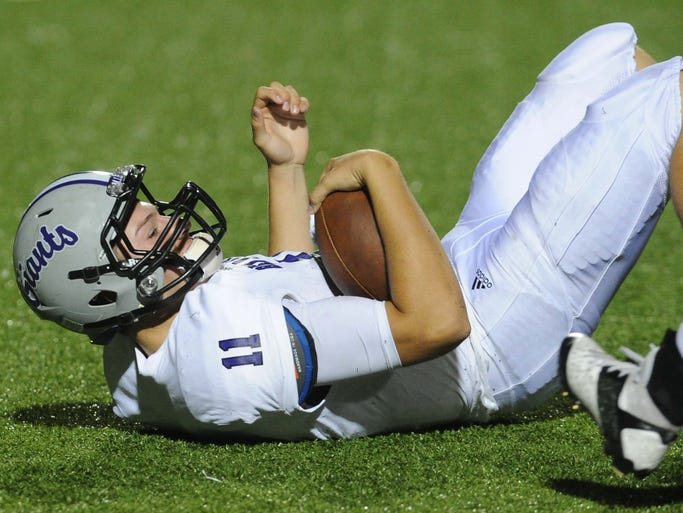 Kyle Castner of BD fell on his  own fumble on a snap exchange in the second quarter. Center Grove hosted Ben Davis in high school football Friday October 4, 2013.