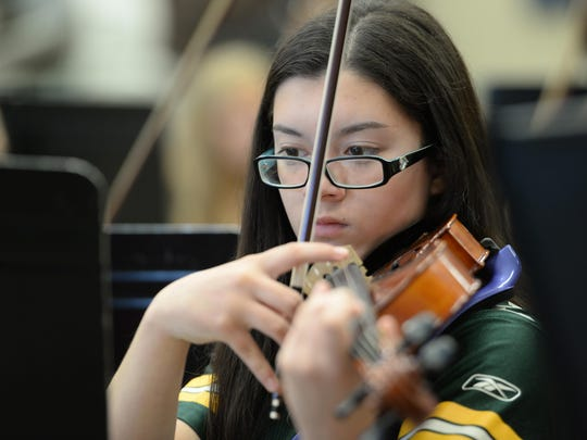 Alex Emerson plays in the Bay Port High School orchestra.