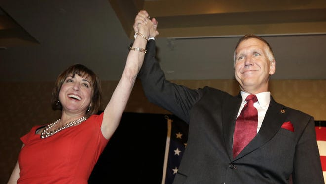 Susan Tillis, left, recently visited cities across North Carolina to fire up women volunteers for her husband Thom Tillis' Senate bid.