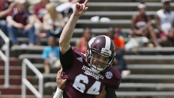 Mississippi State Maroon kicker Evan Sobiesk (64) is lifted up by quarterback Dak Prescott (15) after kicking a 42-yard field goal during the second half of their spring NCAA college football game against the White team, Saturday, April 12, 2014, in Starkville, Miss. Maroon won 41-38.