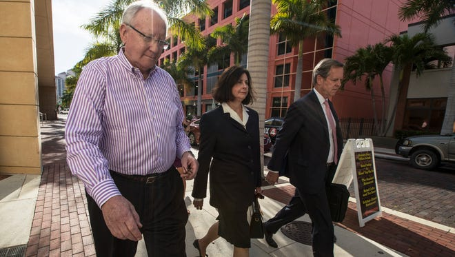 From left, Robert T. Gow and Kay F. Gow walk alongside their attorney John Fitzgibbons after exiting the federal courthouse in downtown Fort Myers Monday afetrnoon. The Gows along with John G. Williams, Jr. were indicted on federal charges with conspiracy to commit wire fraud and money laundering, wire fraud, and illegal monetary transactions.
