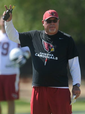 Bruce Arians, head coach of the Arizona Cardinals, runs his team through a morning session of organized team activities or OTAs at the Cardinals training facility in Tempe, AZ on Thursday, June 4 2015. Arians, a native of York County, was named NFL coach of the year for the 2014 season.