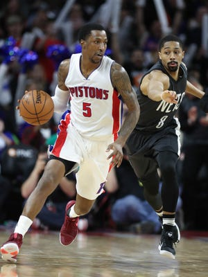 Kentavious Caldwell-Pope drives against Nets guard Spencer Dinwiddie in the fourth quarter of the Pistons' 90-89 win Thursday, March 30, 2017 at the Palace.