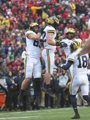 Michigan's Ben Mason, center, celebrates his touchdown in the second quarter against Wisconsin last season.