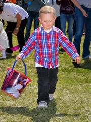 Hunter Bull, 3, begins his search for Easter eggs.