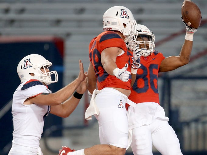 Tight end Jamie Nunley celebrates with quarterback