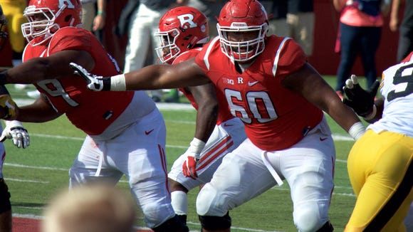 Life at the NFL draft's fringes: Rutgers O-lineman drives for Uber while awaiting the call