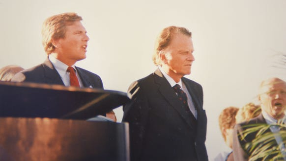 South Dakota governor George Mickelson (left) was part of the program the first night at Howard Wood Field.