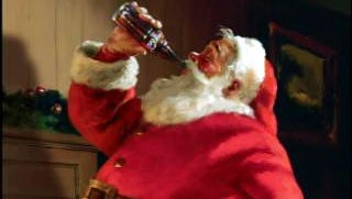 This is how you see Santa, right? Coca-Cola helped him establish a standard wardrobe and keep that rotund girth.
