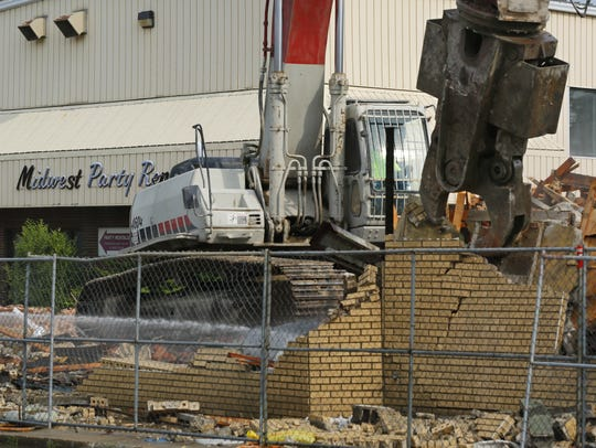 In this photo from 2013, crews start to demolish the