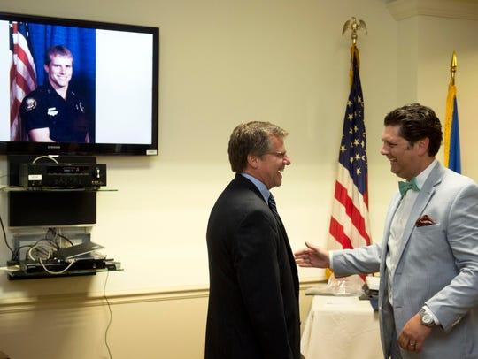 U.S. Marshal Jimmy Fowler talks with Johnathan Sitzlar