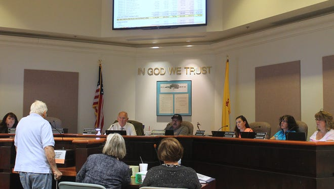 City Commissioners listen to a resident's concerns during the budget hearing held on Thursday evening.