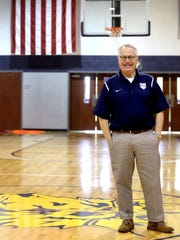 Providence Headmaster Bill Mott in the gym of Providence,