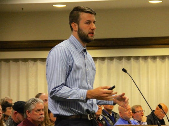 Southern Utah University senior Jackson Rhoton discusses the benefits of building a new animal shelter in Cedar City on Dec. 7, 2016.