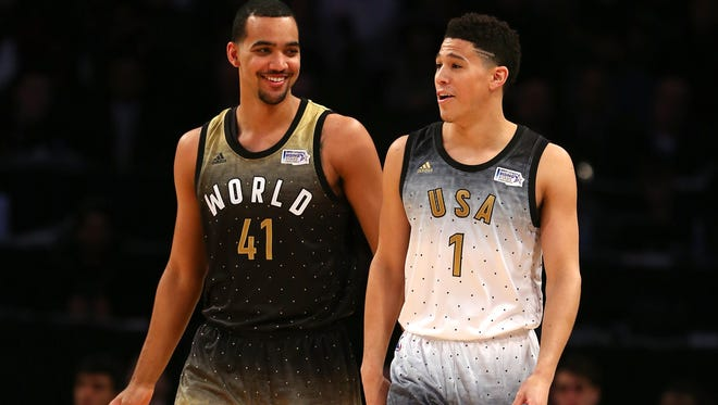 TORONTO, ON - FEBRUARY 12: Trey Lyles #41 of the Utah Jazz and World team reacts with Devin Booker #1 of the Phoenix Suns and the United States team after a play in the first half during the BBVA Compass Rising Stars Challenge 2016 at Air Canada Centre on February 12, 2016 in Toronto, Canada. NOTE TO USER: User expressly acknowledges and agrees that, by downloading and/or using this Photograph, user is consenting to the terms and conditions of the Getty Images License Agreement.  (Photo by Elsa/Getty Images)