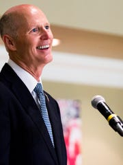 Gov. Rick Scott speaks to the crowd during an event to honor local veterans with the Governor's Veterans Service Award at the Bonita Bay Club on Monday, April 10, 2017.
