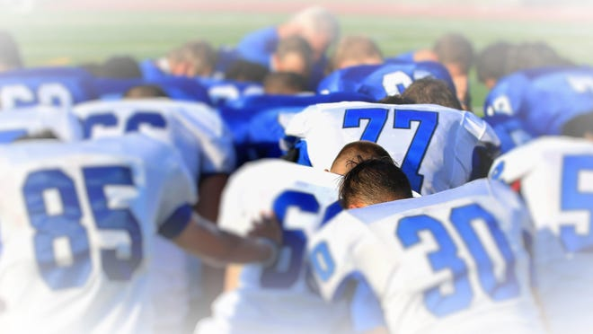 Before last weekend's Blue-White scrimmage, Salem's varsity football team surrounded Alex Howie (No. 77) for a moment of silence. It was to honor his mom Cindy, who lost her long bout with cancer the previous day.