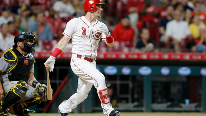 Cincinnati Reds second baseman Scooter Gennett (3) hits a solo home run to right-center field in the bottom of the sixth inning of the MLB National League game between the Cincinnati Reds and the Pittsburgh Pirates at Great American Ball Park in downtown Cincinnati on Wednesday, May 23, 2018. The Reds lost 5-4 in 12 innings.