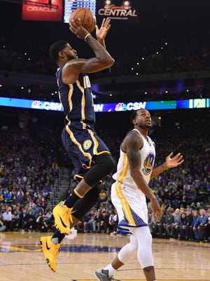 Pacers forward Paul George (13) shot against Warriors forward Andre Iguodala (9) during the first quarter at Oracle Arena on Monday.