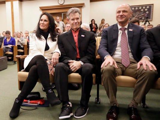 Randy Travis, Mary Travis, Blaise Baxter