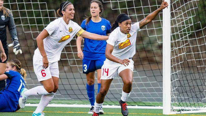 Forward Jess McDonald, right, celebrates scoring the tying goal last weekend in Seattle with teammate, Abby Erceg. McDonald leads the NWSL in assists (5) and points (17) is second in goals (6) through 12 matches.