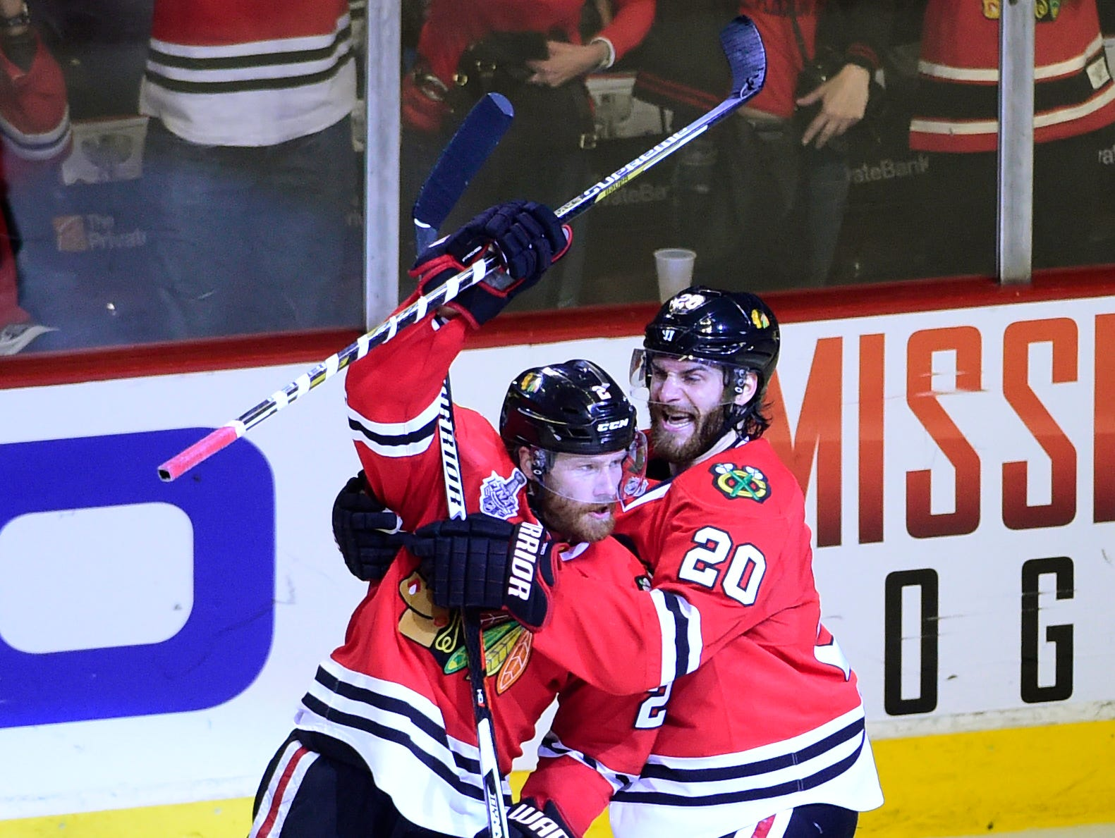 Chicago Blackhawks defenseman Duncan Keith (2) celebrates with left wing Brandon Saad (20) after scoring during the second period of game six of the 2015 Stanley Cup Final against the Tampa Bay Lightning at United Center.