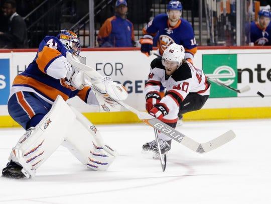 Islanders goalie Jaroslav Halak (41) shoots the puck