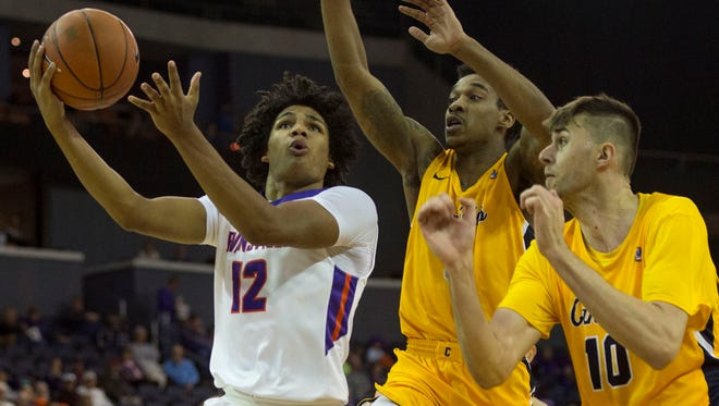 UE's Dru Smith, shown here scoring against Canisius, will miss four weeks because of a stress fracture in his foot.