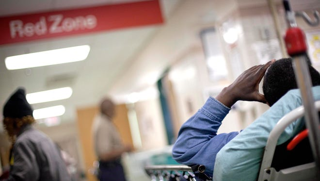 A patient waits in the halls of the trauma unit of the emergency room at Grady Hospital in Atlanta.