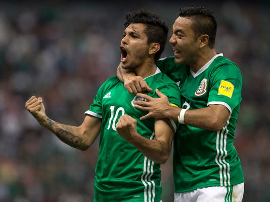 Mexico's Jesus Corona, left, celebrates with teammate Marco Fabian after scoring against Canada during a World Cup qualifying soccer match in Mexico City, Tuesday, March  29, 2016. (AP Photo/Christian Palma)