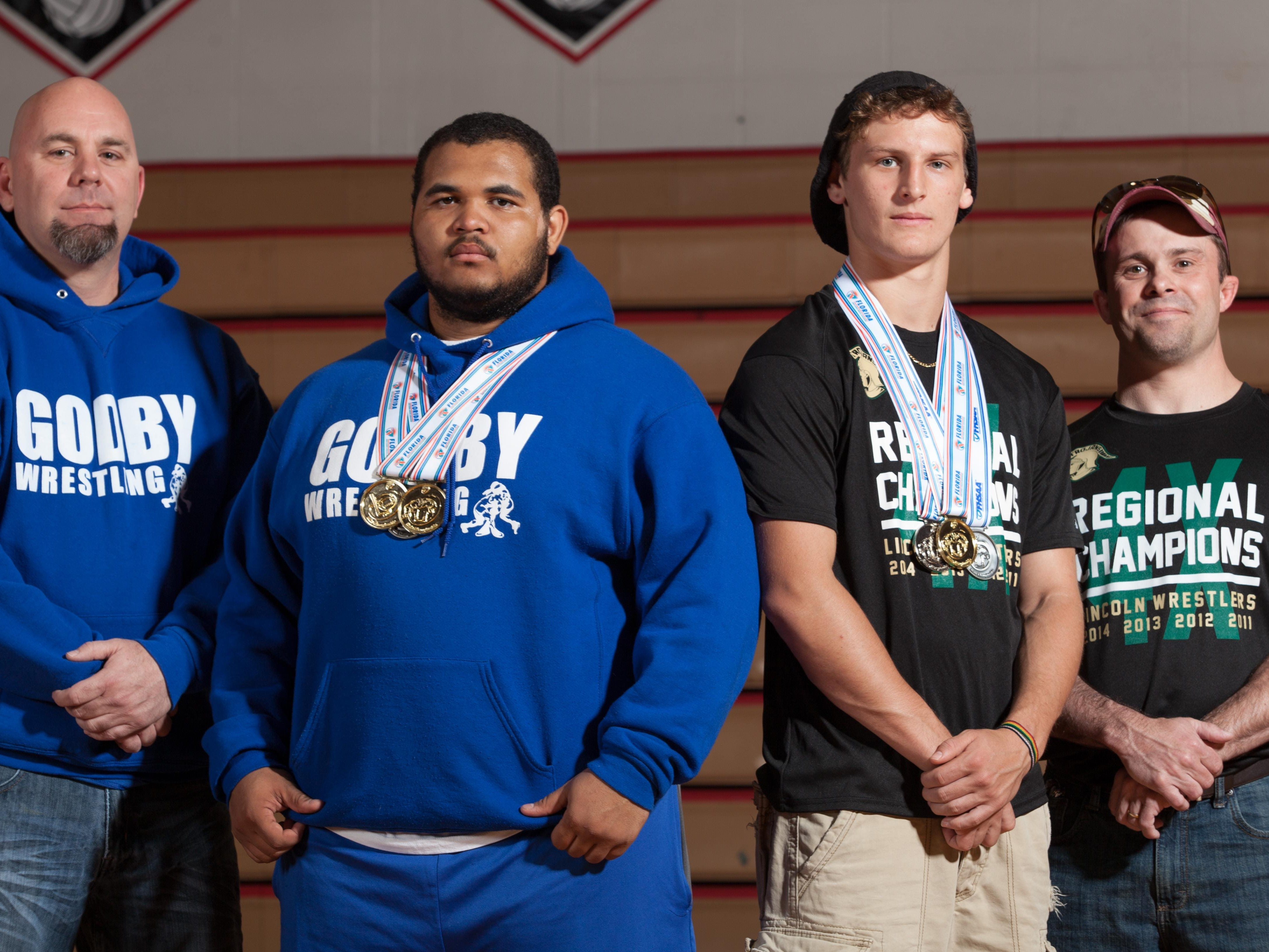 Godby's MaShawn Knight and Lincoln's Tristan Sommer won state titles as seniors during the 2013-14 wrestling season.
