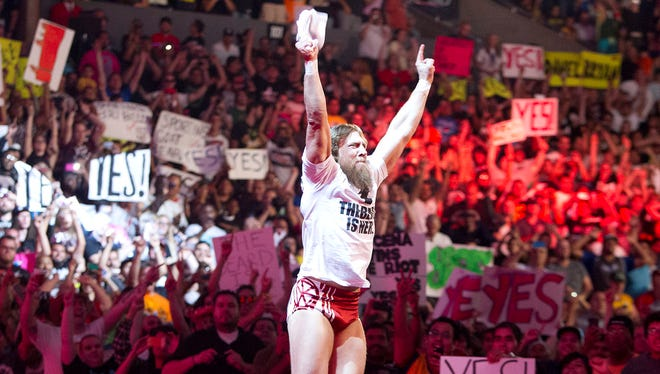 """Daniel Bryan leads the Staples Center crowd in his popular """"Yes!"""" chant at WWE's SummerSlam event on Aug. 18, 2013."""