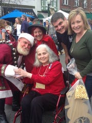 Michelle Griffin, center, in December 2015 at a Franklin Christmas celebration with her son, Doug, and daughter-in-law, Sheryl, about six months before she committed suicide