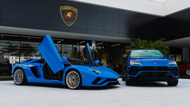"Models Aventador S and Urus outside Lamborghini Palm Beach. General Manager Tom Prawdzik says ""Our clientele still has the means and desire to purchase Lamborghinis."" But the luxury dealership is doing more online advertising, and sales people are doing more Facetime and Skype with customers."
