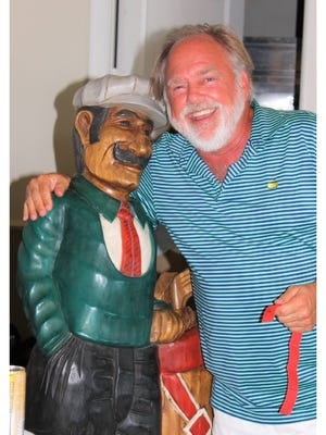 Eric Bergstedt poses with one of the silent auction items at last year's Golf for Hope tournament.