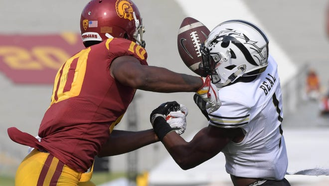 Western Michigan Broncos cornerback Sam Beal (1) intercepts a pass intended for USC receiver Jalen Greene (10) during a game on Sept. 1, 2017.