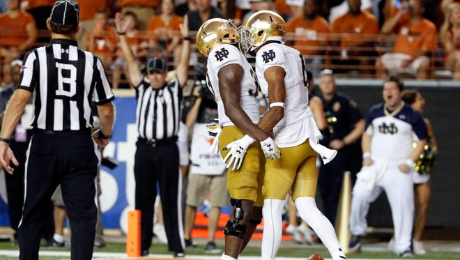 Fighting Irish wide receiver Equanimeous St. Brown (right) and running back Josh Adams (left) are both headed to the NFL draft.