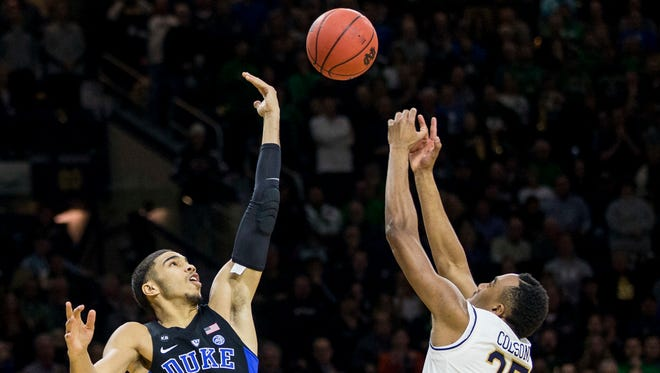 Duke's Jayson Tatum (0) competes for a loose ball with Notre Dame's Bonzie Colson (35) during the first half of an NCAA college basketball game Monday, Jan. 30, 2017, in South Bend, Ind. (AP Photo/Robert Franklin)