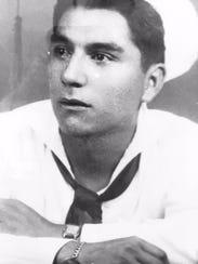 Robert Reyes of Des Moines wearing his Navy uniform