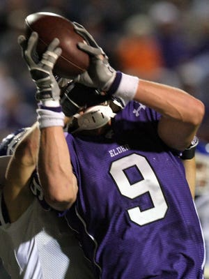 Elder High School's Kyle Rudolph (9) make a touchdown catch over Covington Catholic's Brian Schafer on Oct. 12, 2007 at Nippert Stadium.