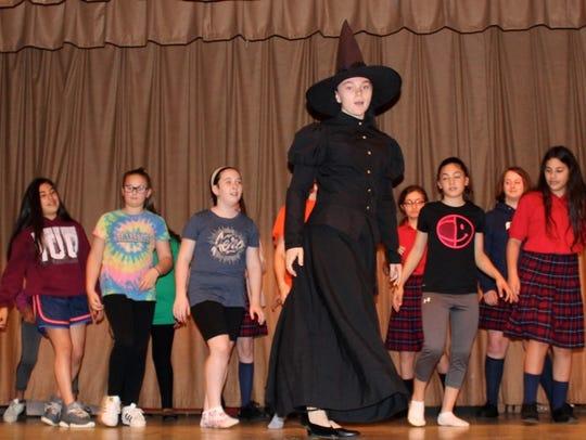 Students from Bishop Schad Regional School rehearse